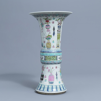 A Chinese famille rose 'gu' vase with antiquities, 20th C.