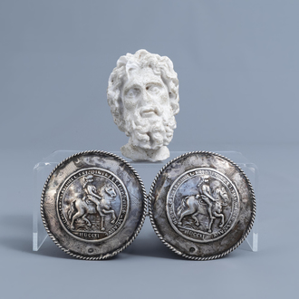 A pair of silver 'horseman' belt buckles and a marble head after the antiques, various origins, 19th/20th C.