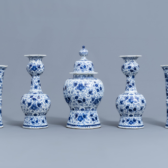 A five-piece Dutch Delft blue and white garniture with floral design, 18th C.