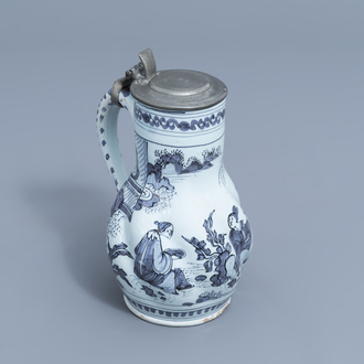 A Dutch Delft blue and white 'chinoiserie' jug with pewter cover, 17th C.
