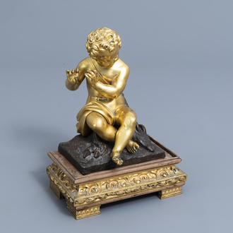 French school: A flute player with a goat, gilt and patinated bronze on a gilt mounted wooden base, 19th C.