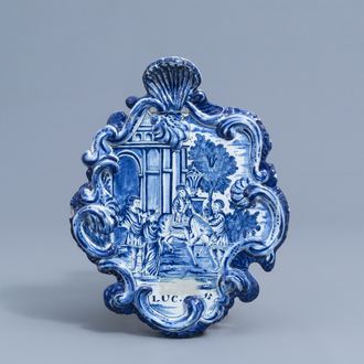 A Dutch Delft blue and white plaque with the prodigal son, 18th C.
