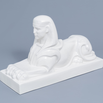 A large white glazed Maastricht earthenware figure of a sphinx, Petrus Regout, first half of the 20th C.