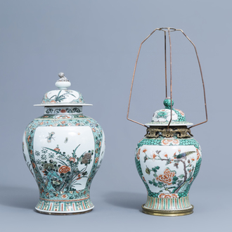 Two Chinese famille verte vases and covers with birds and butterflies among blossoming branches, 19th/20th C.