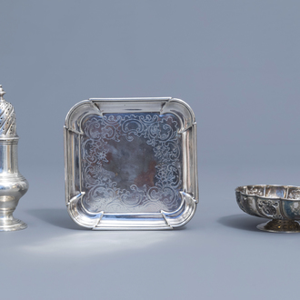 An English silver caster, a bowl on foot and a platter, various marks, 18th/19th C.