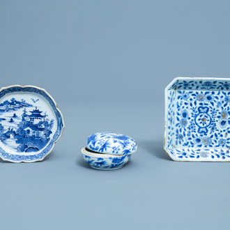Two various Chinese blue and white teapot stands and a box and cover with a bird among blossoming branches, Kangxi and later