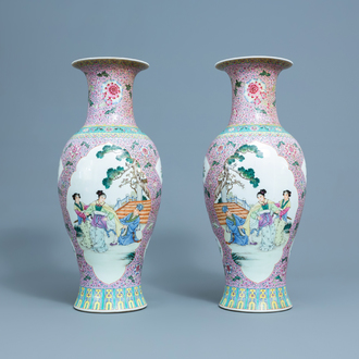 A pair of Chinese famille rose baluster shaped vases with floral design and figures in a garden, 20th C.