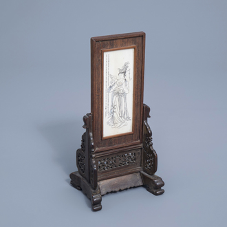 A Chinese wooden table screen with an ivory plaque depicting a lady and a butterfly, ca. 1920