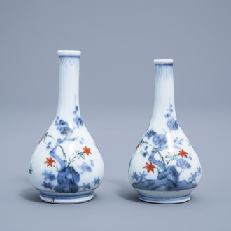 A pair of Japanese Kakiemon doll's house miniature vases with a playing child, Edo, 17de/18de eeuw