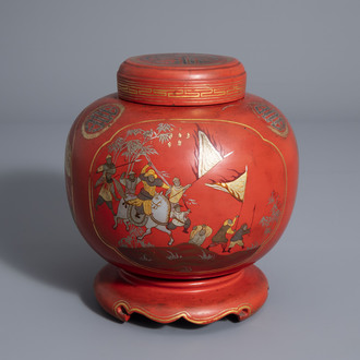 A Chinese painted and red lacquered jar and cover on stand, 19th/20th C.