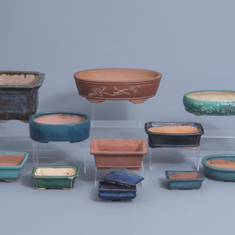 Eleven Chinese glazed pottery and Yixing stoneware jardinières, 20th C.