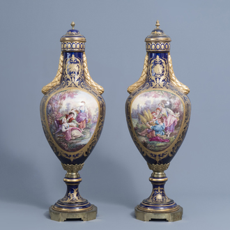 A pair of large French Sèvres style vases and covers with gallant scenes and landscapes, 20th C.