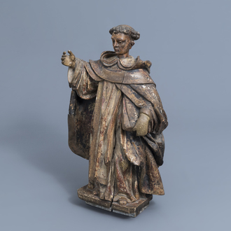 An Italian carved, polychrome painted and gilt wooden figure of Saint Anthony of Padua, 17th/18th C.