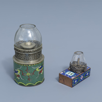 Two Chinese paktong and cloisonné opium lamps with dragons and floral design, 19th C.