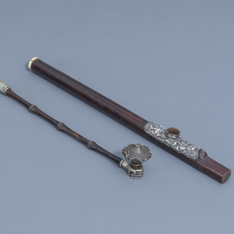 Two Chinese bamboo opium pipes finished with silver, jade, ivory and stoneware, 19th C.