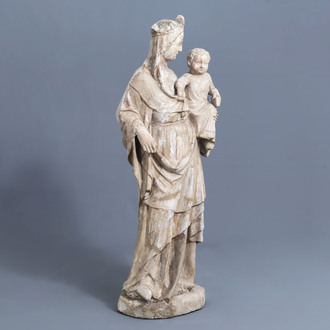 An impressive stone Île-de-France type Madonna and Child with traces of polychromy, 14th C. or later