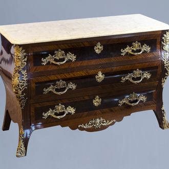 A French veneered gilt bronze mounted Louis XV style chest of drawers with marble top, 20th C.
