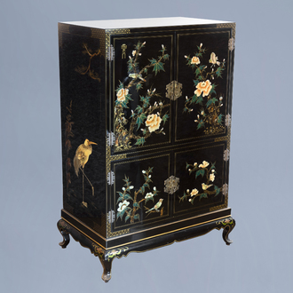 A lacquered Chinese cupboard with birds among blossoming branches, 20th C.