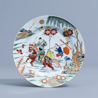 A Chinese famille rose plate with figures in a landscape, 19th/20th C.