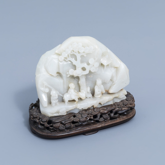 A Chinese double-sided celadon jade boulder with figures in a mountain landscape, 19th/20th C.