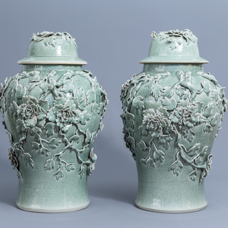A pair of large Chinese celadon crackle glazed vases and covers with floral relief design, 20th C.