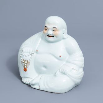 A Chinese white, iron red and gilt porcelain figure of Buddha, 19th/20th C.