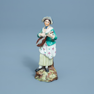 A German polychrome decorated earthenware figure of a lady with a mandolin, Höchst, 18th C.