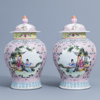 A pair of Chinese famille rose vases and covers with ladies playing music and reading, Qianlong mark, 20th C.