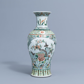 A Chinese famille verte baluster vase with birds among blossoming branches, 19th/20th C.