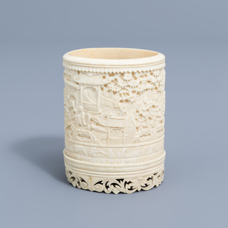 A Chinese richly carved ivory brush pot, Canton, 19th C.