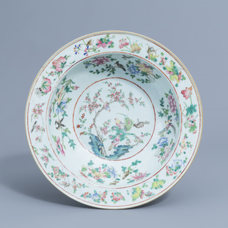 A Chinese famille rose bowl with birds among blossoming branches, 19th C.