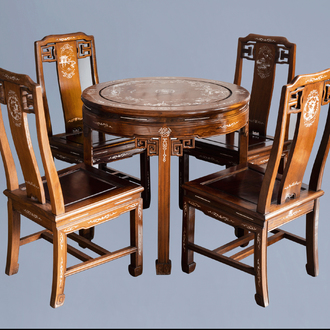 Four Chinese or Vietnamese mother-of-pearl inlaid wooden chairs and a round table, 20th C.
