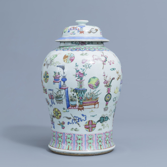 A Chinese famille rose 'antiquities' vase and cover, 19th C.