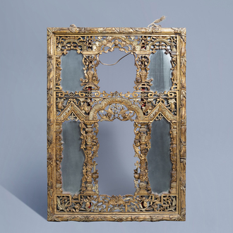 A Chinese open worked gilt wood mirror, 19th C.