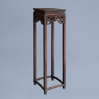 A Chinese carved wooden stand with burl wood top, 19th/20th C.