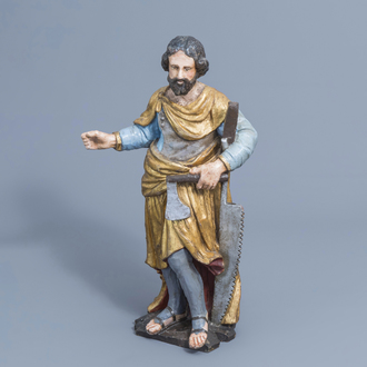 A German carved, polychrome painted and gilt wooden figure of Joseph the Carpenter, 18th C.