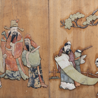 A pair of Chinese wooden panels with soapstone inlaid 'scholars and Immortals' decor, 19th C.