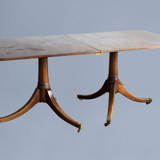 An English George III mahogany twin pedestal dining table, first quarter of the 19th C.