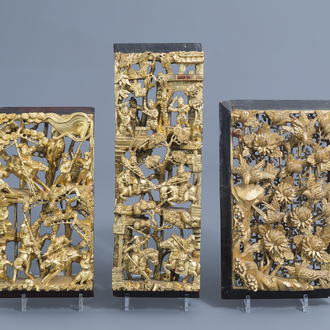 Three Chinese reticulated gilt wooden panels with warrior scenes and birds among blossoming branches, 19th/20th C.