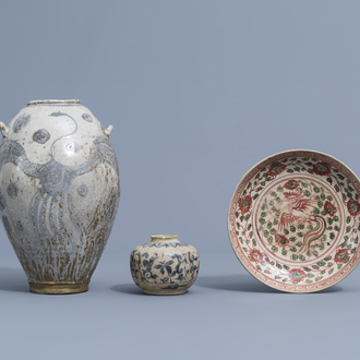 A Chinese Swatow plate, an Annamese blue and white vase and a decorative vase, Ming and later