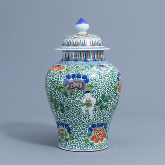 A Chinese wucai 'boys and peony scrolls' vase and cover, Wanli mark, 19th C.