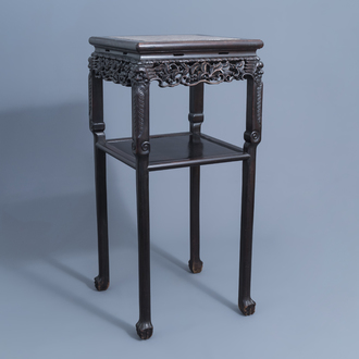 A Chinese carved wooden stand with marble top, 19th/20th C.