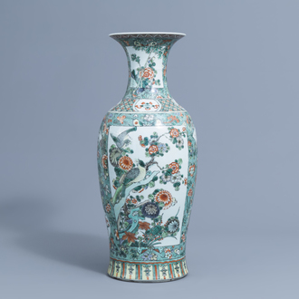 A Chinese famille verte baluster vase with birds among blossoming branches, 19th C.
