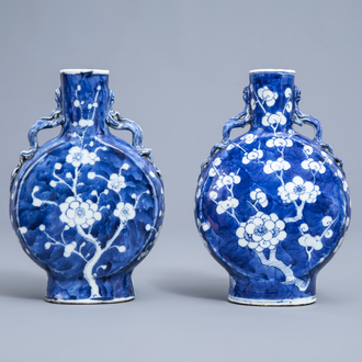 A pair of Chinese blue and white 'prunus on cracked ice' moonflask vases, Kangxi mark, 19th C.