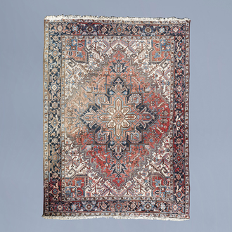 An Oriental Heriz rug with floral design and geometric motifs, wool on cotton, Northwest Persia, first half of the 20th C.