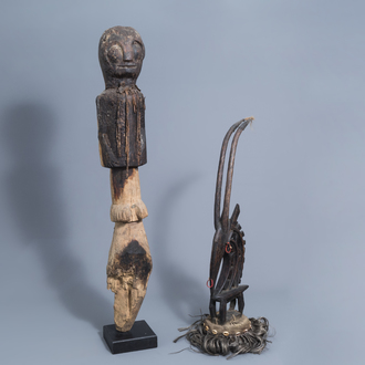 A Chi Wara headdress, Bamana, Mali, and a wooden person shaped sculpture, probably Mbembe, Nigeria, 20th C.