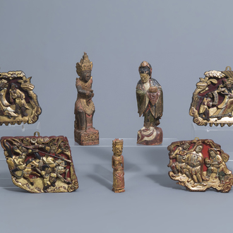 Four lacquered and gilt wood panels with figurative design and three wooden figures, China and Southeast Asia, 19th/20th C.