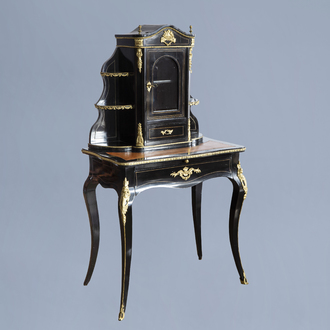 A French ebonised wooden gilt bronze mounted bonheur du jour with glass case, 19th/20th C.
