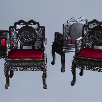 Four Chinese carved wooden chairs with Buddhist lions, 19th/20th C.