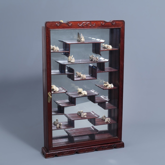 Twelve Japanese animal shaped netsuke in their display cabinet, first half of the 20th C.